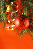 Christmas background. With a bauble and a handbell Royalty Free Stock Photos