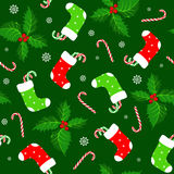 Christmas background. Christmas seamless background with holly and candy canes Royalty Free Stock Photography