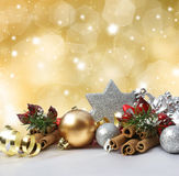 Christmas background. Christmas decorations on a glittery gold background Stock Image