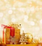 Christmas background. Golden Christmas decorations on shiny background Stock Images