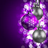 Christmas background. With purple and silver baubles Royalty Free Stock Photos
