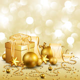 Christmas background. Beautiful golden christmas background this present and baubles Royalty Free Stock Photos