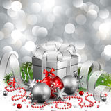 Christmas background. Beautiful silver christmas background with present and balls Royalty Free Stock Images