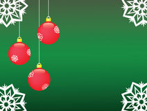Christmas  background. Three red balls over green Stock Image
