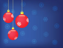 Christmas  background. Three red balls over blue background with snowflakes Royalty Free Stock Image