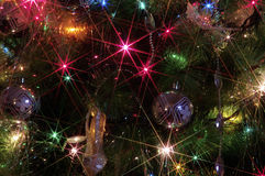 Christmas background. With golden ornaments and Christmas lights Stock Photography