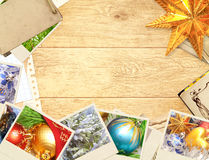 Christmas background. Frame with old photos. Objects over wooden planks Stock Images
