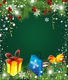 Christmas  background. With holly and gifts Royalty Free Stock Images