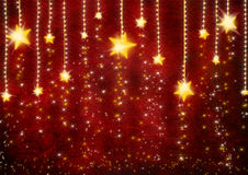 Christmas background. Golden stars over red christmas background Stock Photography