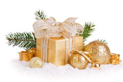Christmas gifts and golden balls. Stock Photos