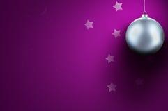 Christmas background. Silver - white Christmas ball on purple background Stock Photo