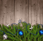 Christmas background. Christmas tree with baubles on wood texture Royalty Free Stock Photos