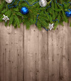 Christmas background. Christmas tree with baubles on wood texture royalty free stock photography