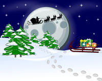 Christmas background. Santa Claus flies reindeer and gifts Stock Photos