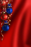 Christmas background. Red and blue balloons with ribbons on a Christmas background Stock Image