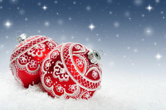 Christmas background. With red bauble on the snow Royalty Free Stock Photos