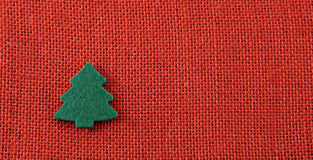 Christmas background. Red jute with green treen Stock Images