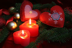 Christmas background. Burning christmas heart candle flame Stock Photography