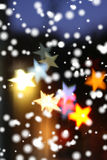 Christmas background. Snow falling over blurred holiday background with star-shaped highlights Stock Illustration