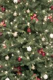 Christmas background. A christmas tree background with star effect on lights Royalty Free Stock Photo