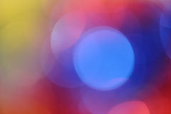 Christmas background. Unfocused multi-colored background with blue, yellow and red colors Royalty Free Stock Photography