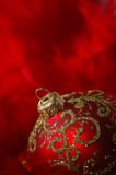 Christmas   background. Christmas-tree decoration on the red feather background Royalty Free Stock Image