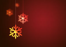 Christmas background. Christmas snowflake hanging on red background Royalty Free Stock Images
