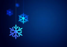 Christmas background. Christmas snowflake hanging on blue background Stock Images