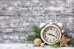 Christmas background with alarm clock, branches of fir tree and Stock Image