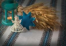 Christmas background with angel lantern and Didukh (diduch) Royalty Free Stock Images