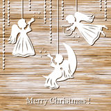 Christmas background with angels. Cut of paper on wood stock illustration