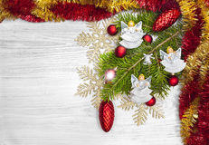 Christmas background with angels, decoration on a wooden board. Royalty Free Stock Images