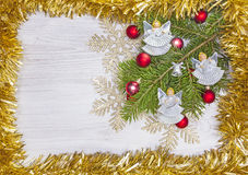 Christmas background with angels, decoration on a wooden board. Stock Images