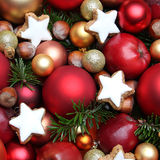 Christmas background with apples, cookies, nuts and baubles Stock Images