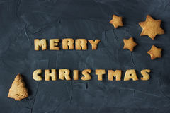 Christmas background with baked gingerbread stars, christmas tree and words merry christmas. creative idea Stock Photography