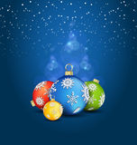 Christmas background with ball decorations. Christmas ball decorations in various colors on the dreamy blue background Stock Photo