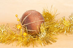 Christmas background with a ball and a tinsel Stock Images