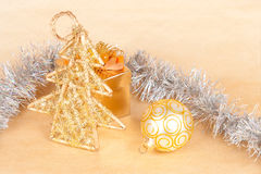 Christmas background with a ball and a tinsel Royalty Free Stock Image