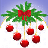 Christmas background with balls. Abstract composition of New Year's with fir branches and red balls Stock Photos