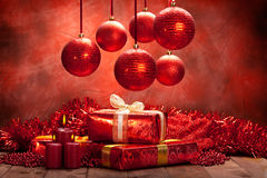 Christmas background - balls, candles and gifts Stock Images