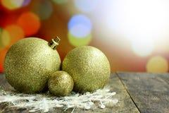 Christmas background balls on dark wooden desk table. Stock Photo
