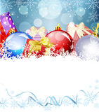 Christmas background with balls and gifts Stock Images