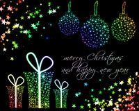 Christmas Background. Christmas balls and gifts on black background with multicolored stars Royalty Free Stock Images