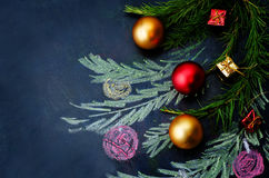 Christmas background with balls and gifts and a Christmas tree Royalty Free Stock Images