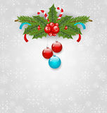 Christmas background with balls, holly berry, pine and sweet can Royalty Free Stock Photo
