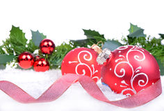Christmas background with balls and holly leaves and berries stock photos