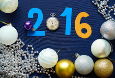 Christmas background with balls, pocket watches and figures Royalty Free Stock Photography