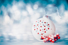 Christmas background with balls and red festive decoration at winter bokeh background Stock Photo