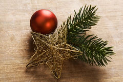 Christmas background with bauble and decorations. Christmas background with bauble and pine branches on wooden table Stock Photos