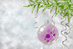 Christmas background with bauble and fir. Light Christmas background with Christmas ball, snowflakes and fir branch Stock Images